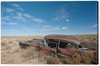 Old rusted car in the middle of New Mexico desert