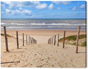 Canvas Print path to sandy beach by North sea