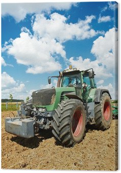 Canvas Print Ploughing tractor at field cultivation work