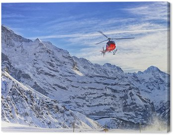 Canvas Print Red helicopter flying at swiss alps near Jungfrau mountain