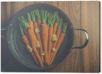 Canvas Print Rustic carrots in a large pan on wood