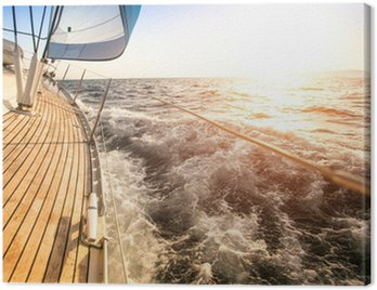 Canvas Print Sailing to the Sunrise. Luxury yacht.
