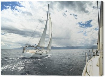 Canvas Print Sailing yacht on the race in a stormy sea.