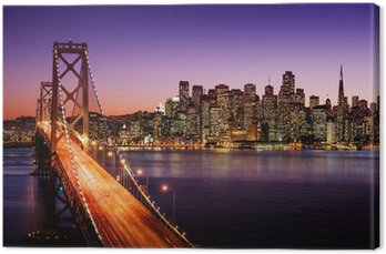 San Francisco skyline and Bay Bridge at sunset, California