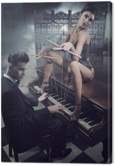 Sensual woman in sexy lingerie sitting on a piano
