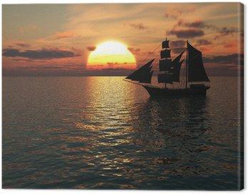 Canvas Print Ship out at sea at sunset.