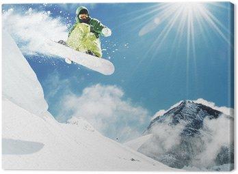 Canvas Print Snowboarder at jump inhigh mountains