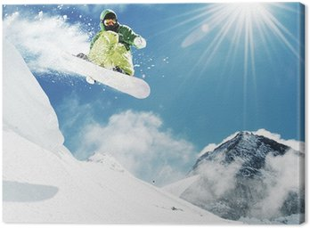 Canvas Print Snowboarder at jump inhigh mountains