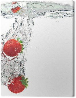 strawberries are dropped into water