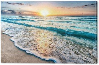 Canvas Print Sunrise over beach in Cancun