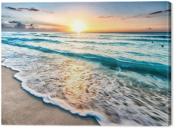 Canvas Print Sunrise over beach in Cancun