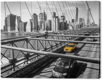 Taxi cab crossing the Brooklyn Bridge in New York Canvas Print