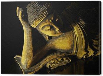 Teak wood lying buddha on black