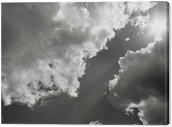 Canvas Print The Sun Breaks Through The Clouds. Black And White Photo