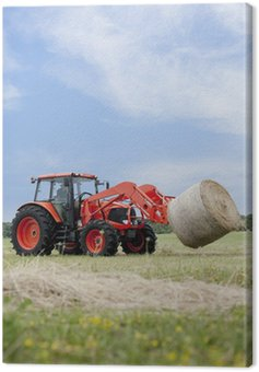 Tractor Hauling Round Bale