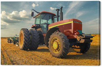 Canvas Print Tractor on the agricultural field