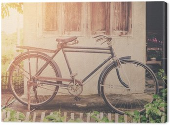 Canvas Print Vintage bicycle or old bicycle vintage park on old wall home.