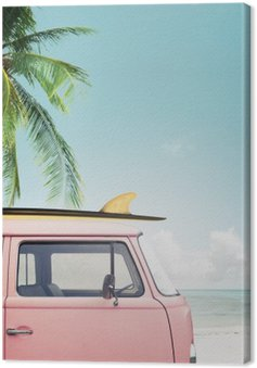 Vintage car parked on the tropical beach (seaside) with a surfboard on the roof Canvas Print