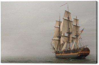 Vintage Frigate sailing into a fog bank