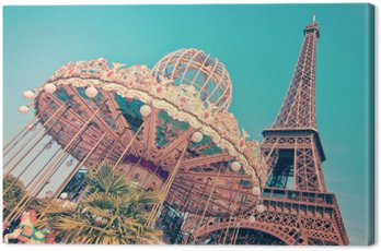 Vintage merry-go-round and the Eiffel tower, Paris France