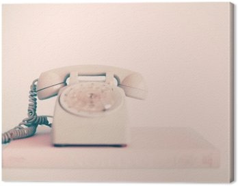 Vintage pink telephone over books