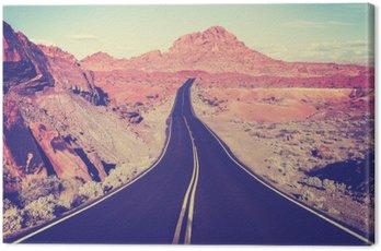 Vintage toned curved desert highway, travel concept, USA