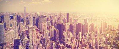 Vintage toned Manhattan skyline at sunset, NYC, USA.