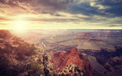 Vintage toned sunset over Grand Canyon, one of the top tourist destinations in the United States.