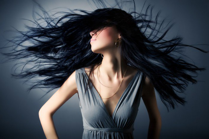 Woman with fluttering hair Canvas Print - Fashion