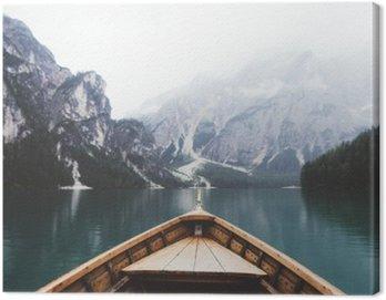 Wood boat in Braies lake