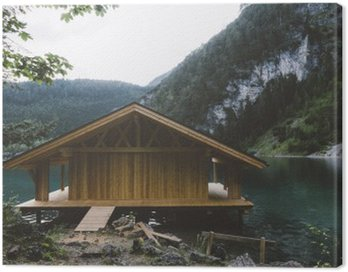 Wood house on lake with mountains and trees