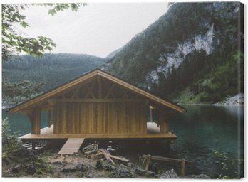 Canvas Print Wood house on lake with mountains and trees