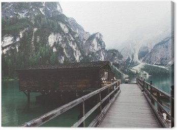Canvas Print wooden jetty on Braies lake with mountains and trees