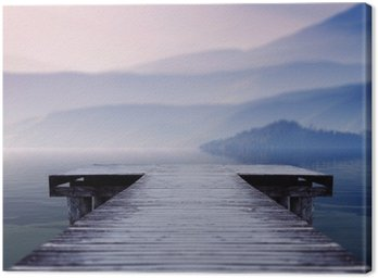 Canvas Print wooden pier on lake site facing a beautiful mountain on a misty winter morning
