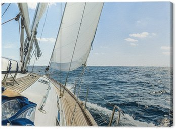 Yacht sail in the Atlantic ocean at sunny day cruise Canvas Print
