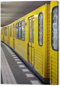 Yellow metro in subway station. Berlin, Germany. Canvas Print