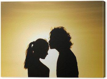 Canvastavla Älskande par silhuett kyssas i solnedgången
