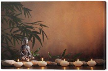 Canvastavla Buddha med brinnande ljus och bambu