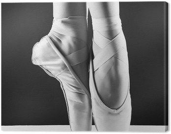 Canvastavla Ett foto av ballerina s pointes på svart bakgrund