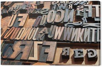 Canvastavla Ett gäng gamla vintage träblock tryckpress bokstäver.