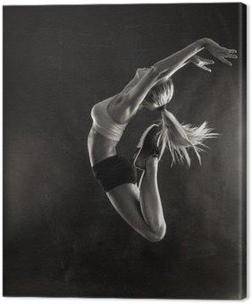 Canvastavla Fitness kvinnlig kvinna med muskulös kropp hoppning.