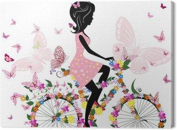 Canvastavla Flicka på en cykel med en romantisk fjärilar