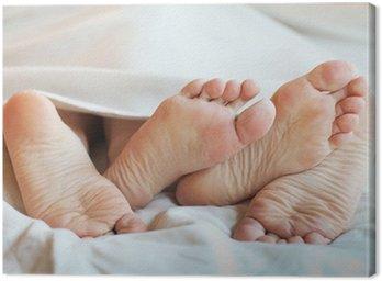 Canvastavla Fötter par i sängen