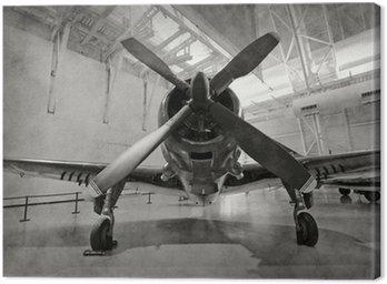 Canvastavla Gamla flygplan i en hangar