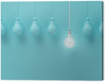 Canvastavla Hängande glödlampor med glödande en annan idé på ljusblå bakgrund, Minimal begrepp idé, platt låg, topp