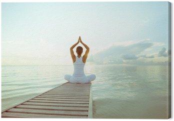 Canvastavla Kaukasisk kvinna yoga på stranden