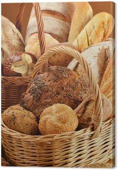 Canvastavla Komposition med bröd och rullar i flätade korgar
