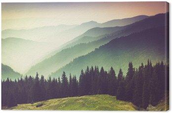 Canvastavla Lager av berg och dis i dalarna.