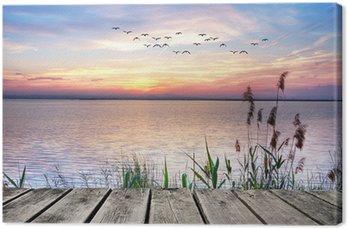 Canvastavla Lake av färgglada moln