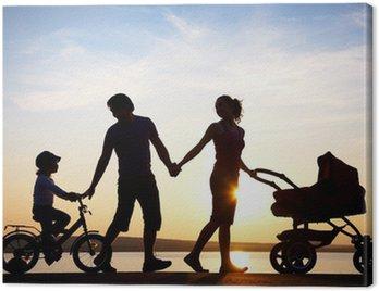 Canvastavla Lycklig familj går på solnedgången